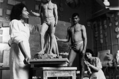 Rehana Mogul and Mani Turner at work in sculpture class at the J.J. School of Arts. A live male model can be seen in the background. Bombay, late 1930s