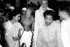 Mahatma Gandhi arriving at the end of the meeting of the Congress Committee, where its members debated and voted for the Third June Plan, the decision to partition the country. He was accompanied by Khan Abdul Ghaffar Khan and Sushila Nayar, his personal physician. June 1947