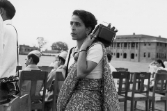 Homai with her smaller Speed Graphic camera on her shoulder