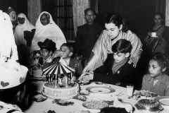 Indira Gandhi with Rajiv Gandhi at his birthday party at Teen Murti House. Delhi, 1950s