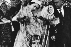 Queen Elizabeth II with a garland presented to her in Madras. 1961