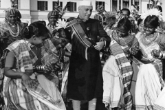 Jawaharlal Nehru posing with dancers on Republic Day at Teen Murti House. Delhi, 1950s